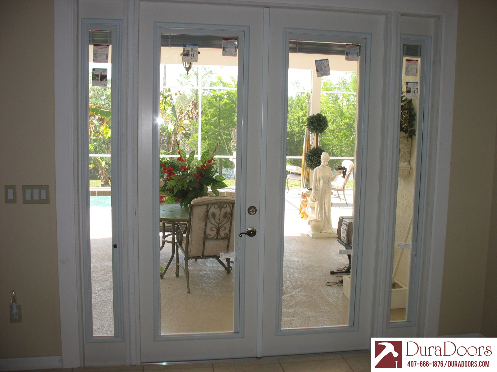 This Windermere FL customer had us replace their sliding glass doors with French doors. They selected the Plastpro French doors with ODL enclosed blinds. & French Doors with ODL Enclosed Blinds | DuraDoors